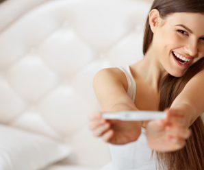 Happy Woman With Pregnancy Test